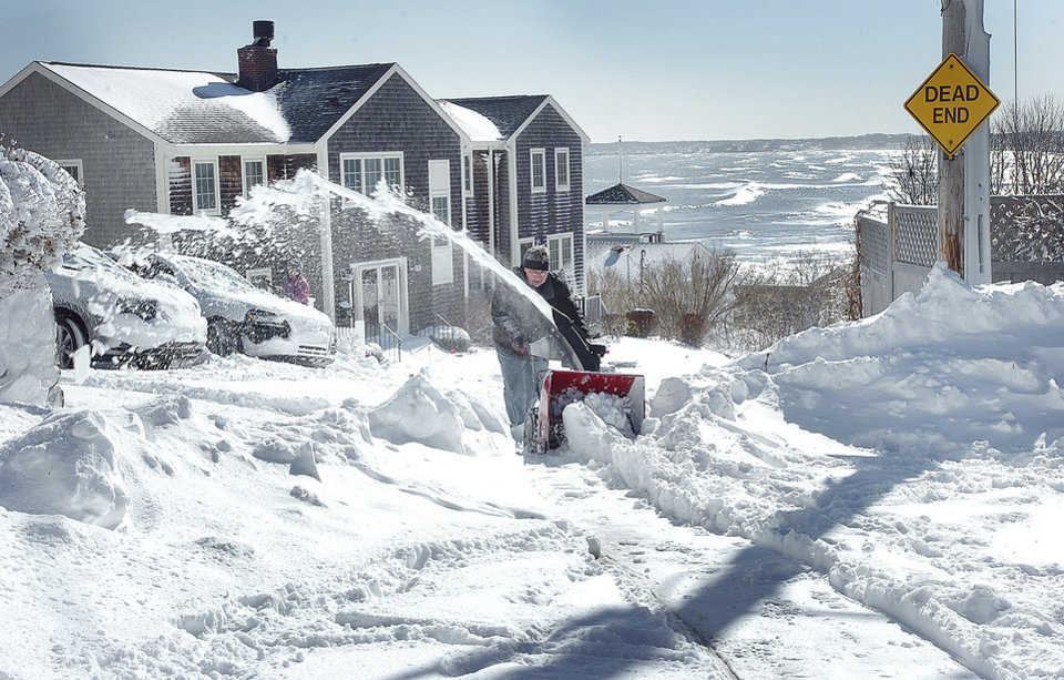 Dave Engelkemeyer plows snow in front of his home on Allerton Hill in Hull, Mass., Sunday, Feb. 10, 2013, after more than two feet of snow blanketed the region from a storm that ended Saturday. (AP Photo/The Patriot Ledger, Gary Higgins)  BOSTON OUT