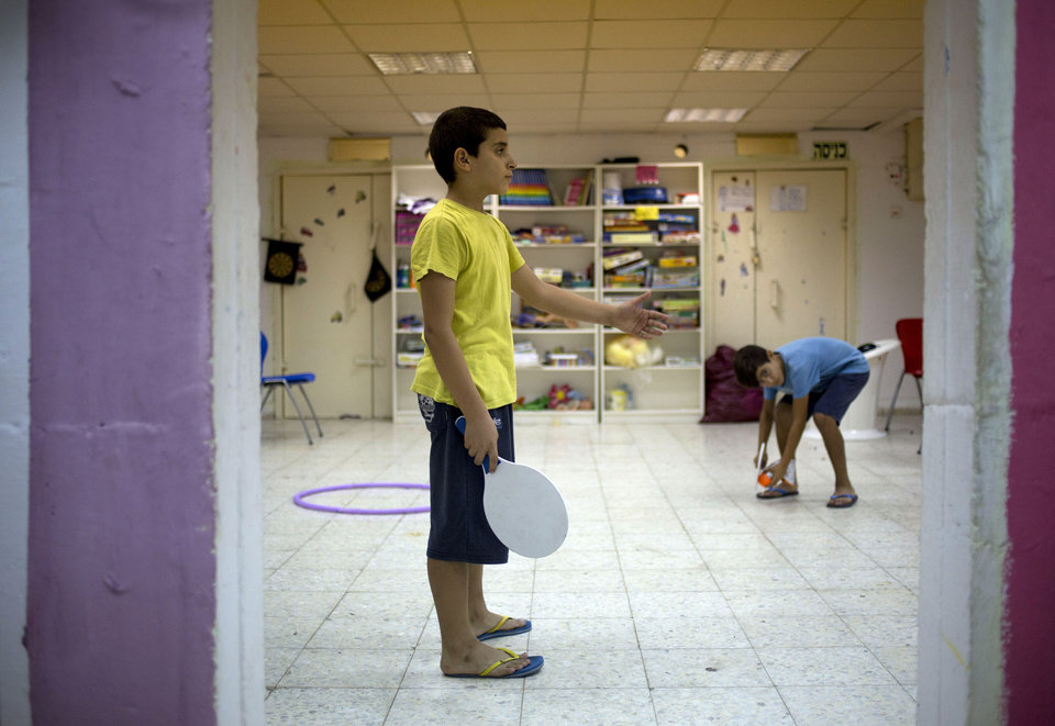 Photo - Israeli children play in a public bomb shelter near in a residential area in Sderot, southern Israel, Wednesday, July 16, 2014. The Palestinian death toll in nine days of fighting rose to 204, with some 1,450 wounded, Palestinian health officials said. On the Israeli side, one man was killed and several people were wounded since the fighting erupted on July 8. (AP Photo/Ariel Schalit)