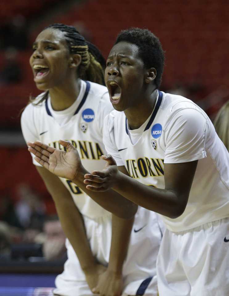 Photo - California's Afure Jemerigbe, right, and  Reshanda Gray cheer from the bench in the the second half of a second-round game against South Florida in the women's NCAA college basketball tournament in Lubbock, Texas, Monday, March 25, 2013. California 82-78 in overtime. (AP Photo/LM Otero)