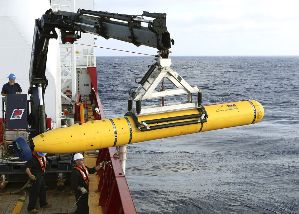 Photo - In this Monday, April 14, 2014, photo provided by the Australian Defense Force an autonomous underwater vehicle is prepared to be deployed from ADV Ocean Shield in the search of the missing Malaysia Airlines Flight 370 in the southern Indian Ocean. The search area for the missing Malaysian jet has proved too deep for the robotic submarine which was hauled back to the surface of the Indian Ocean less than half way through its first seabed hunt for wreckage and the all-important black boxes, authorities said on Tuesday. (AP Photo/Australian Defense Force, Lt. Kelli Lunt) EDITORIAL USE ONLY