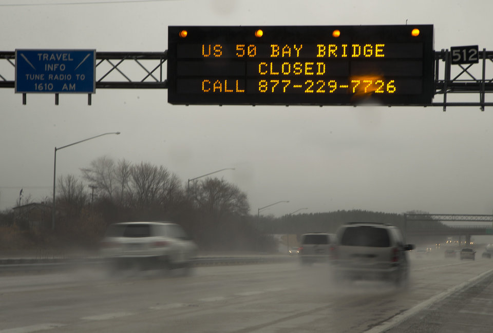 Photo - A sign spanning Interstate 97 South in Millersville, Md., Wednesday, March 6, 2013,  alerts travelers that the Chesapeake Bay Bridge is closed in both directions because of high winds, according to he Maryland Transportation Authority.  (AP Photo/Carolyn Kaster)
