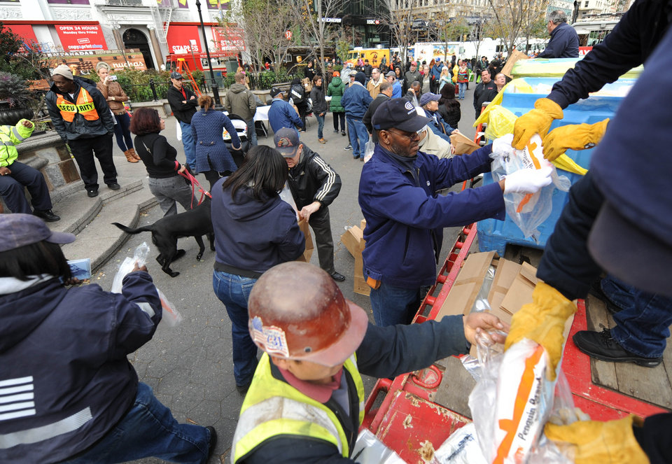 Dry ice is unloaded from a flatbed truck in Union Square for distribution to residents of the still powerless Chelsea section of Manhattan, Thursday, Nov.1, 2012, in New York. Three days after superstorm Sandy walloped the city, residents and commuters still faced obstacles as they tried to return to pre-storm routines. (AP Photo/ Louis Lanzano) ORG XMIT: NYLL107