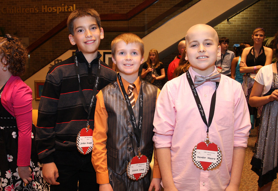 Jordan Knapp, 11, Calvin Long, 10, Xander Moore, 10. PHOTO BY DAVID FAYTINGER, FOR THE OKLAHOMAN <strong></strong>