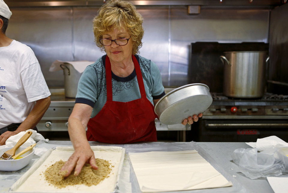 Photo - Connie Dantes make Baklava with others at St. George's Greek Orthodox Church in Oklahoma City, Saturday, Sept. 1, 2012. Photo by Bryan Terry