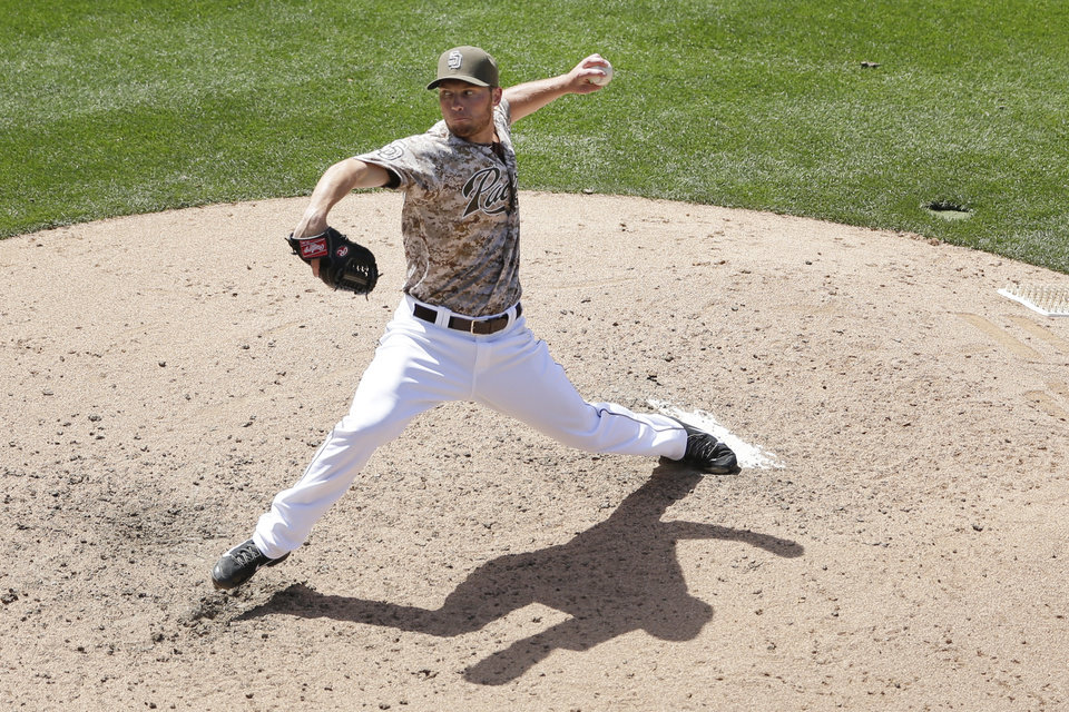 Photo - San Diego Padres starting pitcher Robbie Erlin pitches to a Miami Marlins batter during the fourth inning of a baseball game Sunday, May 11, 2014, in San Diego. (AP Photo/Gregory Bull)
