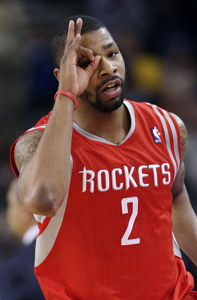 Houston Rockets' Marcus Morris (2) reacts after making a three-point basket against the Golden State Warriors during the second half of an NBA basketball game in Oakland, Calif., Tuesday, Feb. 12, 2013. Houston won 116-107. (AP Photo/Marcio Jose Sanchez)