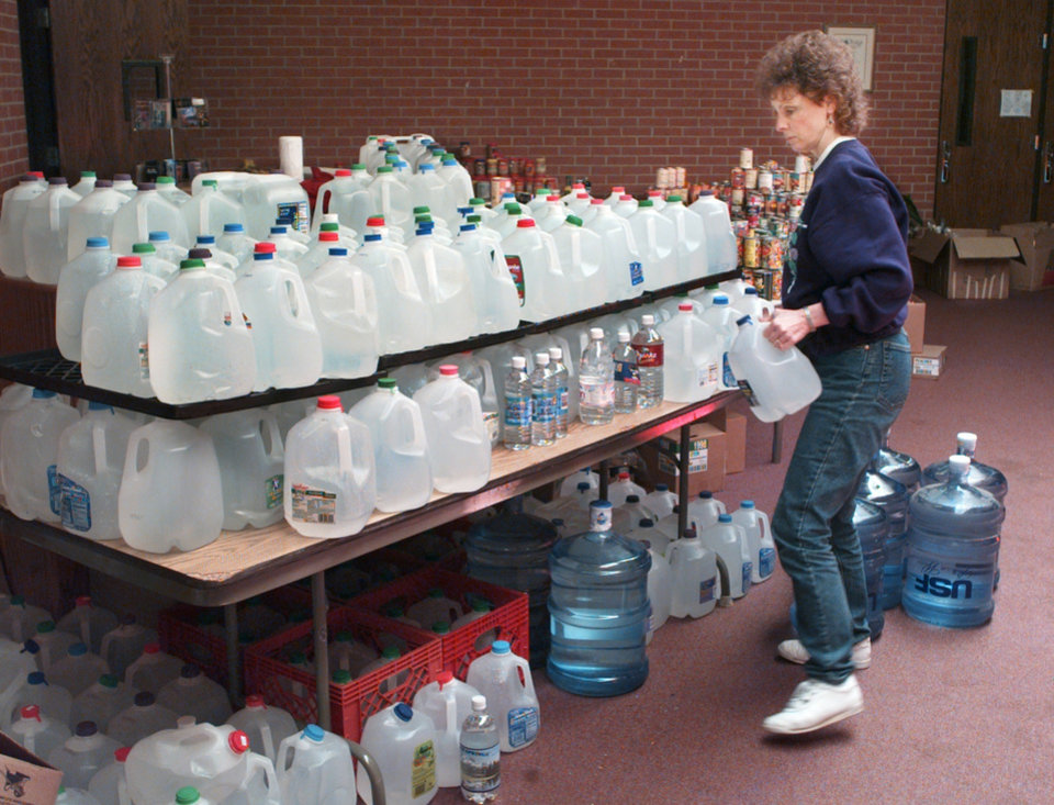 Donations, tornado relief: Moore's First Baptist Church.  Church member and disaster volunteer Nancy Mitchell of South Okla. City inside the First Baptist Church of Moore at I-35 and 27th street stacking donated water.