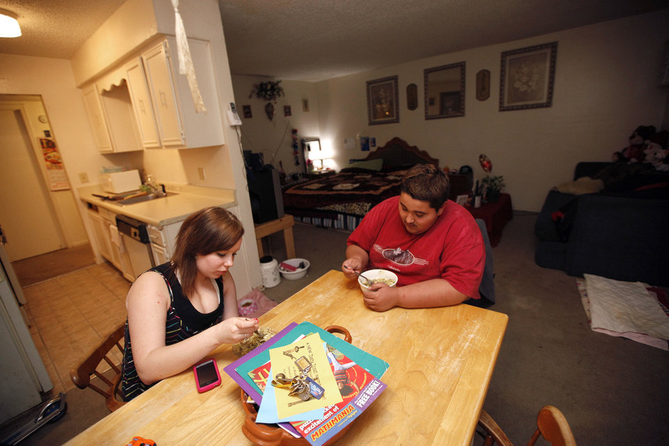 Renae and Juan eat dinner at her Oklahoma City home, Thursday, Feb. 9, 2012. Photo by Sarah Phipps, The Oklahoman