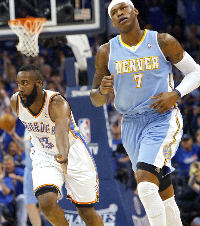 Photo - Oklahoma City's James Harden celebrates a three-pointer he scored over Denver's Al Harrington (right) during the first round NBA Playoff basketball game between the Thunder and the Nuggets at OKC Arena in downtown Oklahoma City on Wednesday, April 20, 2011. Photo by John Clanton, The Oklahoman