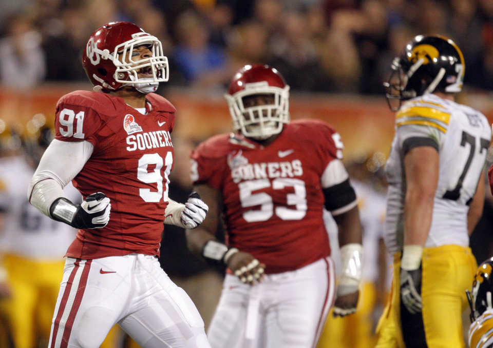 Photo - Oklahom's R.J. Washington (91) celebrates a sack during the Insight Bowl college football game between the University of Oklahoma (OU) Sooners and the Iowa Hawkeyes at Sun Devil Stadium in Tempe, Ariz., Friday, Dec. 30, 2011. Photo by Sarah Phipps, The Oklahoman