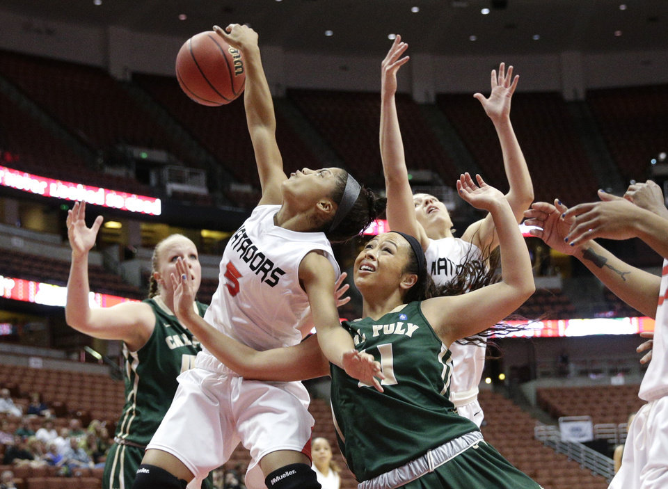 Photo - Cal State Northridge's Ashlee Guay (5) and Cal Poly's Kristen Ale (11) fight for a rebound during the first half of an NCAA college basketball game in the final of the Big West Conference tournament, on Saturday, March 15, 2014, in Anaheim, Calif. (AP Photo/Jae C. Hong)