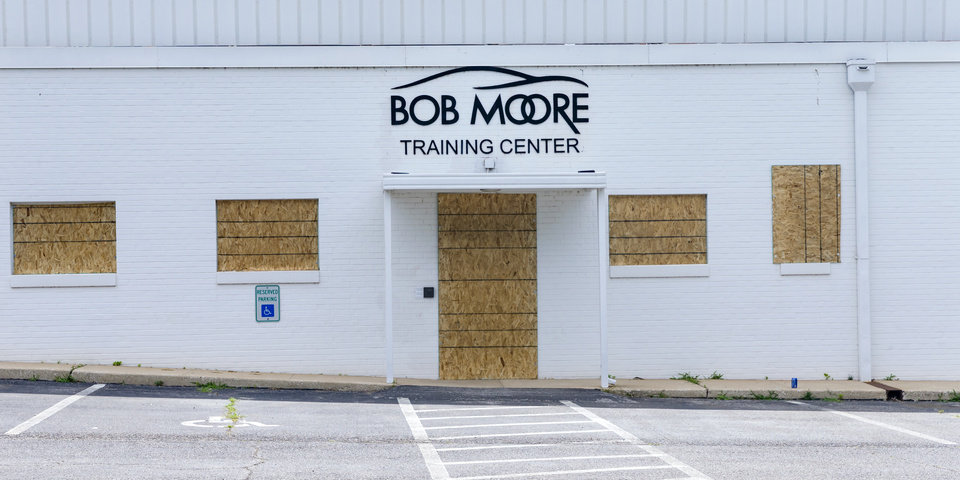 Photo - Crews work to board up windows and repair damage to the Bob Moore Training Center near NW 5th St. and Shartel Ave. on Monday, June 1, 2020, in Oklahoma City, Okla. that was left behind after the George Floyd protest. [Chris Landsberger/The Oklahoman]