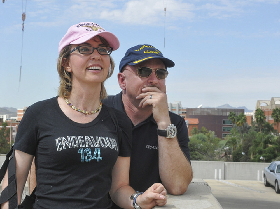 Photo -   In this photo provided by the Southwest Photo Bank, former U.S. Rep. Gabrielle Giffords and husband, former astronaut Mark Kelly, watch the Space Shuttle Endeavor fly over Tucson, Ariz. on its way to Los Angeles, Thursday, Sept. 20, 2012. Kelly, Endeavour's last commander, requested that the shuttle pass over Tucson to honor Giffords, who is recovering after suffering a head wound in a shooting rampage last year. (AP Photo/Southwest Photo Bank, P.K. Weis) MANDATORY CREDIT