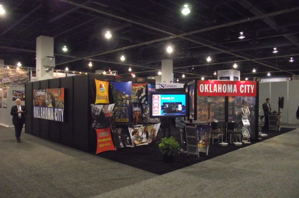 Photo - Oklahoma City's booth is shown at the International Council of Shopping Centers conference this week in Las Vegas.   PROVIDED BY THE GREATER OKLAHOMA CITY CHAMBER     ORG XMIT: 1005252220032892
