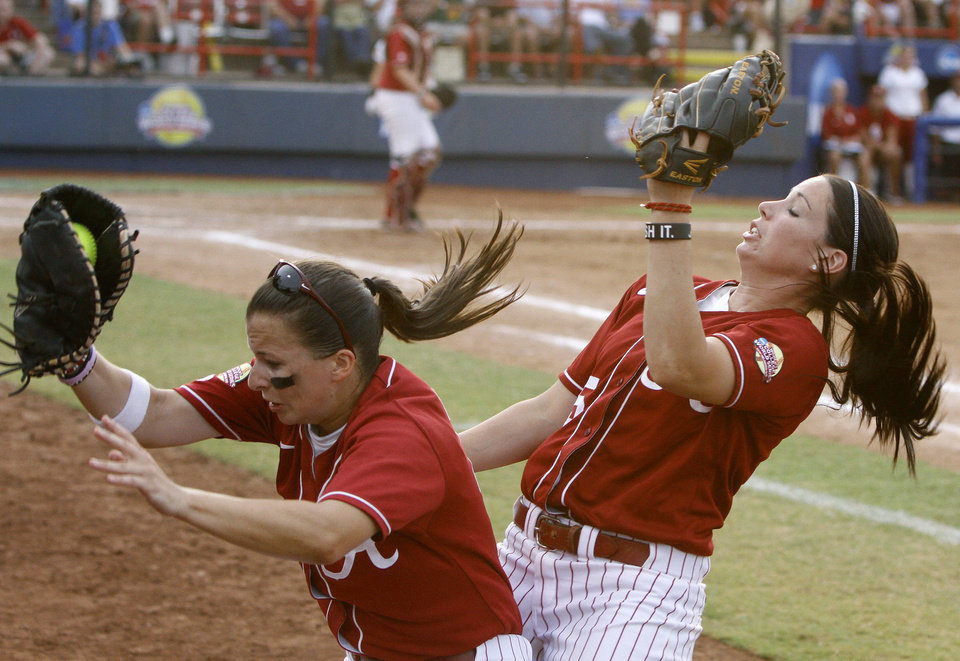 Photo - Alabama's Cassie Reilly-Boccia, left, is hit by Alabama's Danae Hays (15) as she makes a catch in the second inning against Oklahoma during the championship game of the Women's College World Series as ASA Stadium in Oklahoma City, Tuesday, June 5, 2012. Photo by Bryan Terry, The Oklahoman