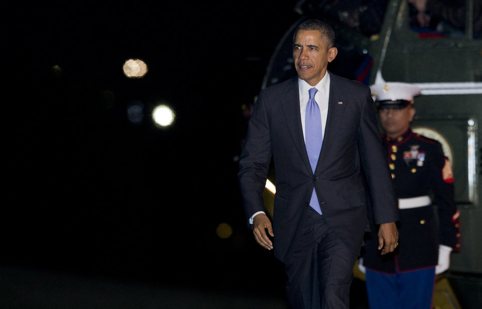 Photo - President Barack Obama arrives at the White House in Washington, early Friday, March 21, 2014, from a trip in Florida.  (AP Photo/Manuel Balce Ceneta)