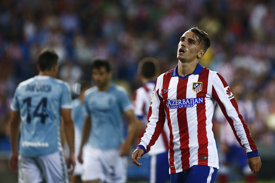 Photo - Atletico's Antoine Griezmann, right,  gestures during a Spanish La Liga soccer match between Atletico de Madrid and Eibar at the Vicente Calderon stadium in Madrid, Spain, Saturday, Aug. 30, 2014. (AP Photo/Andres Kudacki)
