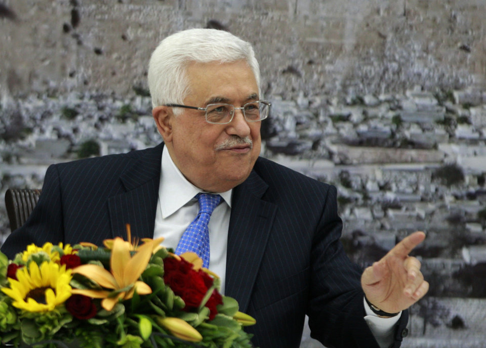 Palestinian President Mahmoud Abbas attends a meeting of the Palestinian leadership in the West Bank city of Ramallah, Thursday, July 18, 2013. Abbas convened a special gathering of top Palestinian officials for what could be a make-or-break decision on U.S. Secretary of State John Kerry's latest efforts to relaunch peace talks with Israel. (AP Photo/Majdi Mohammed)