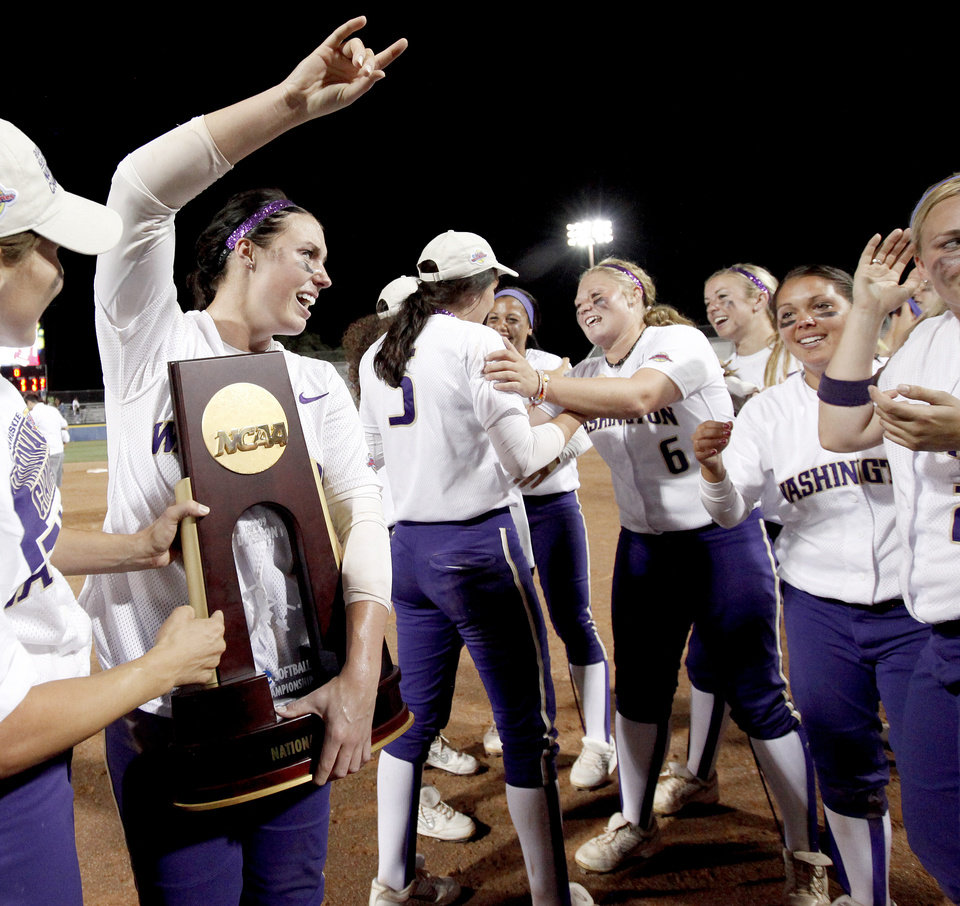 Photo - Washington's Danielle Lawrie celebrates after Washington's 3-2 win after the second softball game of the championship series between Washington and Florida in Women's College World Series at ASA Hall of Fame Stadium in Oklahoma City, Tuesday, June 2, 2009. Photo by Bryan Terry, The Oklahoman