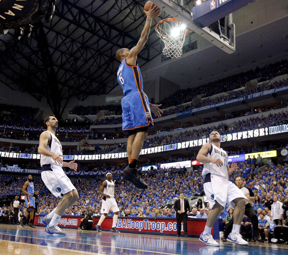Oklahoma City\'s Eric Maynor (6) goes to the basket between Peja Stojakovic (16) and Jose Juan Barea (11) of Dallas during game 2 of the Western Conference Finals in the NBA basketball playoffs between the Dallas Mavericks and the Oklahoma City Thunder at American Airlines Center in Dallas, Thursday, May 19, 2011. Photo by Bryan Terry, The Oklahoman
