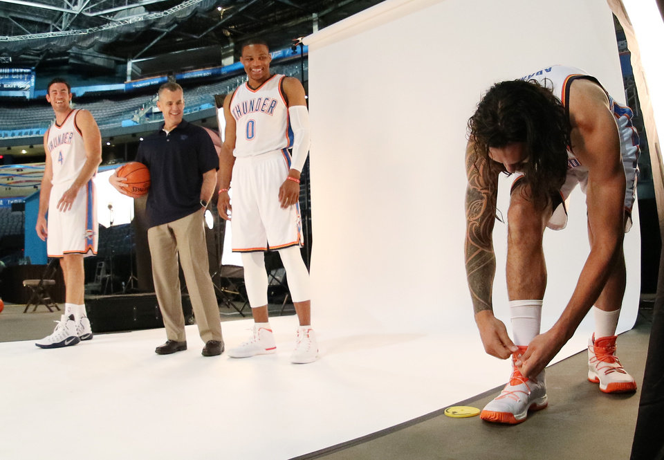 Photo - Steven Adams ties his shoes as Nick Collison, Coach Billy Donovan and Russell Westbrook wait during the Oklahoma City Thunder media day, Friday, September 23, 2016. Photo by Doug Hoke, The Oklahoman