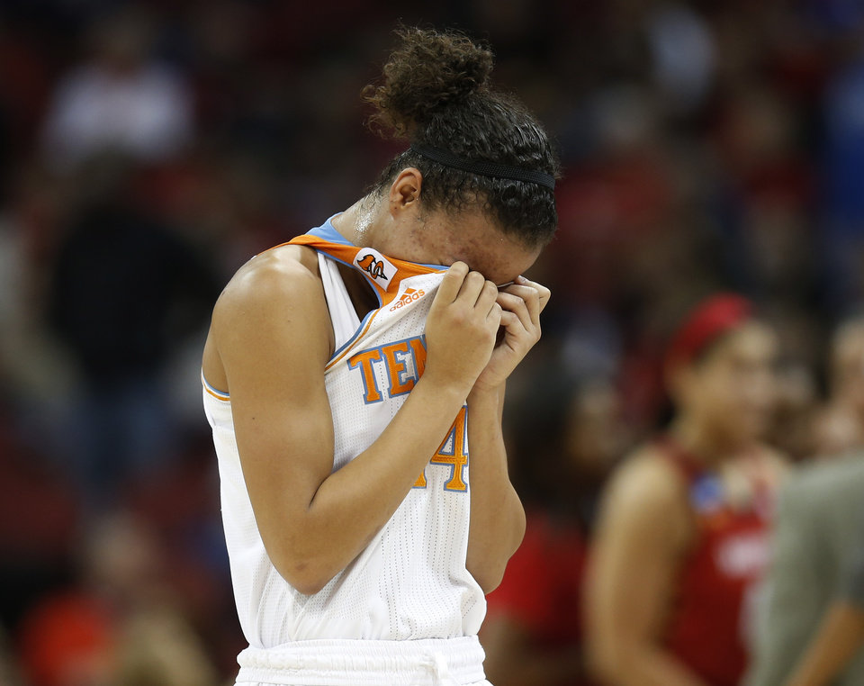 Photo - Tennessee guard Andraya Carter (14) leaves the court after losing 73-62 to Maryland in a regional semifinal game at the NCAA college basketball tournament on Sunday, March 30, 2014, in Louisville, Ky. (AP Photo/John Bazemore)
