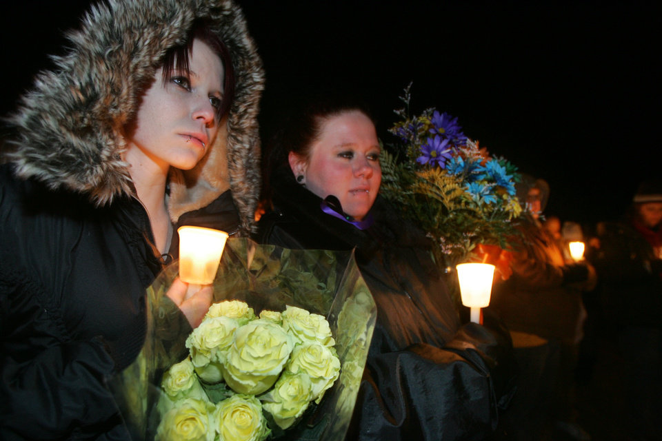Kayla James and Nicole Williams take part in a candlelight vigil in El Reno , Okla. January  15, 2009.  BY STEVE GOOCH, THE  OKLAHOMAN.