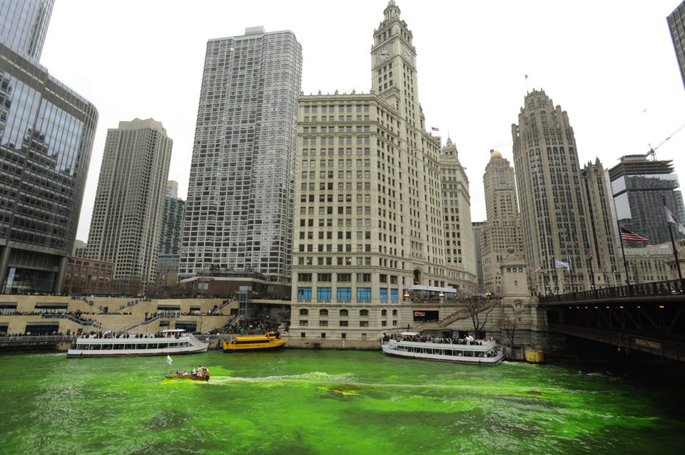 Photo - The Chicago River is dyed green right before the start of the St. Patrick's Day parade in Chicago, Saturday, March, 16, 2013.  With the holiday itself falling on a Sunday, many celebrations were scheduled instead for Saturday because of religious observances. (AP Photo/Paul Beaty)