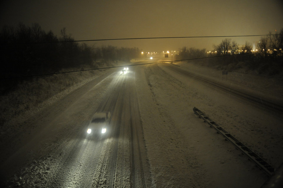 Photo - Motorists travel slowly on a snow-covered Interstate 24 during a winter storm Wednesday, December 26, 2012, in Paducah, Ky. The storm dumped several inches of snow making travel hazardous. (AP Photo/Stephen Lance Dennee)