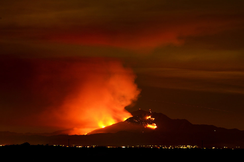 Photo - A wildfire burns out of control on the slopes of Mount Diablo in Contra Costa County, Calif., seen from the Woodbridge Ecological Reserve located in the Sacramento–San Joaquin River Delta, Sunday, Sept. 8, 2013. By nightfall, it had surged to 800 acres, state fire officials said, spewing a plume of smoke visible for miles and leading to the evacuation of 50 to 75 homes in Clayton, a town of about 11,000 people alongside the park. (AP Photo/The Modesto Bee, Andy Alfaro) LOCAL TV OUT (KXTV10, KCRA3, KOVR13, FOX40, KMAX31, KQCA58, CENTRAL VALLEY TV); LOCAL PRINT OUT (TURLOCK JOURNAL, CERES COURIER, OAKDALE LEADER, MODESTO VIEW, PATTERSON IRRIGATOR, MANTECA BULLETIN, RIPON, RECROD, SONORA UNION DEMOCRAT, AMADOR LEDGER DISPATCH, ESCALON TIMES, CALAVERAS ENTERPRISE, RIVERBANKS NEWS) LOCAL INTERNET OUT (TURLOCK CITY NEWS.COM, MOTHER LODE.COM)