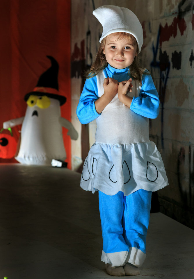 Photo - Moira wears a soft and comfortable Smurfette costume, sold at Party Galaxy. Photo by Chris Landsberger, The Oklahoman  CHRIS LANDSBERGER