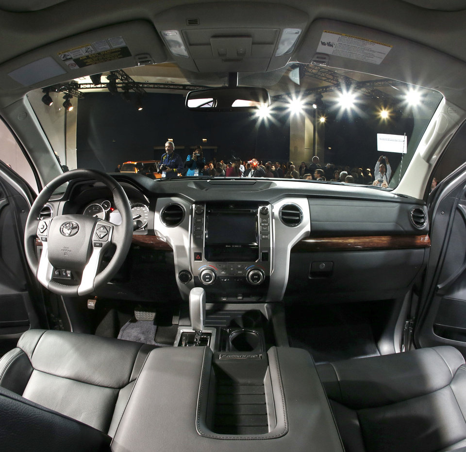 Photo - The interior of the redesigned 2014 Toyota Tundra is unveiled at the Chicago Auto Show on Thursday. AP PHOTO  Charles Rex Arbogast - AP