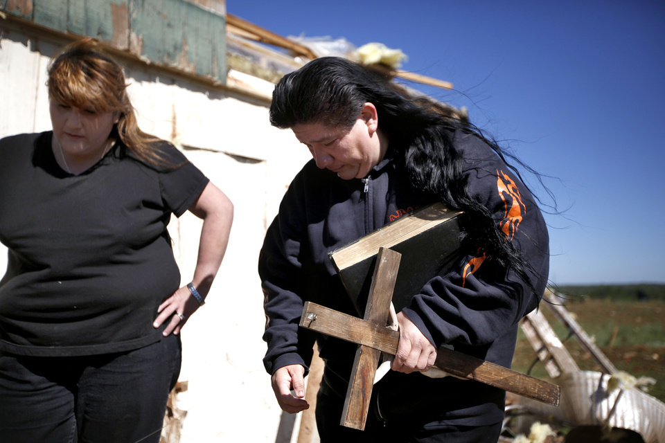 Irma Sanchez and Nancy Rodriguez react after finding the family bible at their brother\'s mobile home at the Hideaway mobile home park, Sunday, April, 15, 2012, in Woodward, Okla. A tornado struck Woodward early Sunday morning. Photo by Sarah Phipps, The Oklahoman.