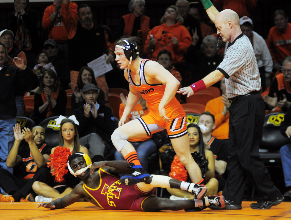 Photo - Oklahoma State 125-pound wrestler Eddie Klimara gets up after defeating Iowa State's Earl Hall in overtime at a wrestling dual between Oklahoma State and Iowa State at Gallagher Iba Arena in Stillwater on January 24, 2014. Oklahoma State defeated Iowa State 29-3. Photo by KT King/For the Oklahoman