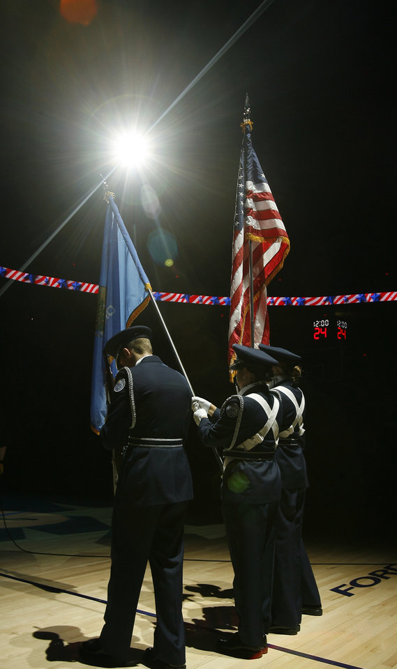 Photo - The Crooked Oak High School presents the colors before the start of the NBA game between Oklahoma City Thunder and the Atlanta Hawks, Sunday, Nov. 9, 2008, at  the Ford Center, Oklahoma City. PHOTO BY SARAH PHIPPS, THE OKLAHOMAN