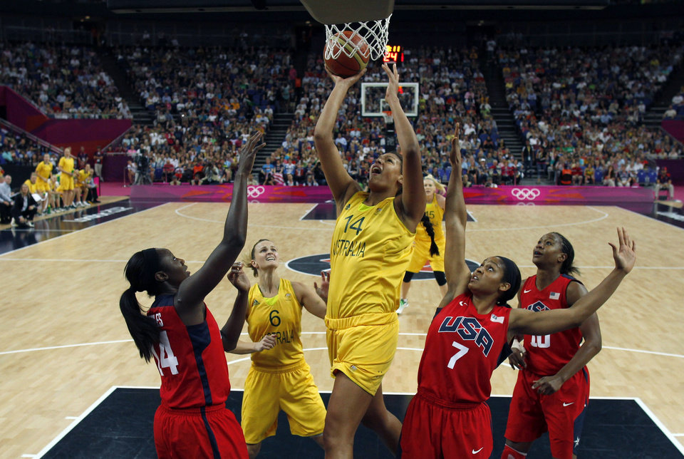 Photo -  Australia's Liz Cambage, center, shoots over United States' Maya Moore, right, and Tina Charles during their women's basketball semifinal match at the 2012 Summer Olympics on Thursday, Aug. 9, 2012, in London. (AP Photo/Sergio Perez, Pool)