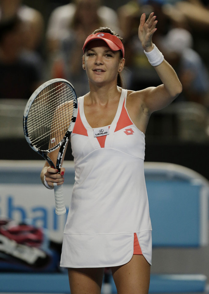 Photo - Poland's Agnieszka Radwanska waves to the crowd following her third round win over Britain's Heather Watson at the Australian Open tennis championship in Melbourne, Australia, Friday, Jan. 18, 2013. (AP Photo/Rob Griffith)
