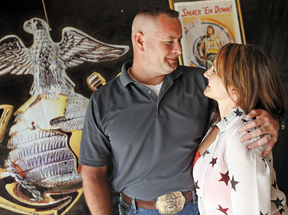 Photo - Brandon Douglas and his wife, Jennifer Douglas, pose for a photo at their home in Oklahoma City, Monday, July 1, 2013. Brandon Douglas left the Marines as a Gunnery Sergeant after battling PTSD. Photo by Nate Billings, The Oklahoman