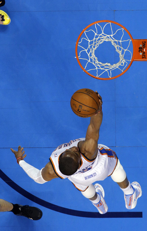 Photo - Oklahoma City's Russell Westbrook (0) shoots a lay up during Game 1 in the first round of the NBA playoffs between the Oklahoma City Thunder and the Memphis Grizzlies at Chesapeake Energy Arena in Oklahoma City, Saturday, April 19, 2014. Photo by Sarah Phipps, The Oklahoman