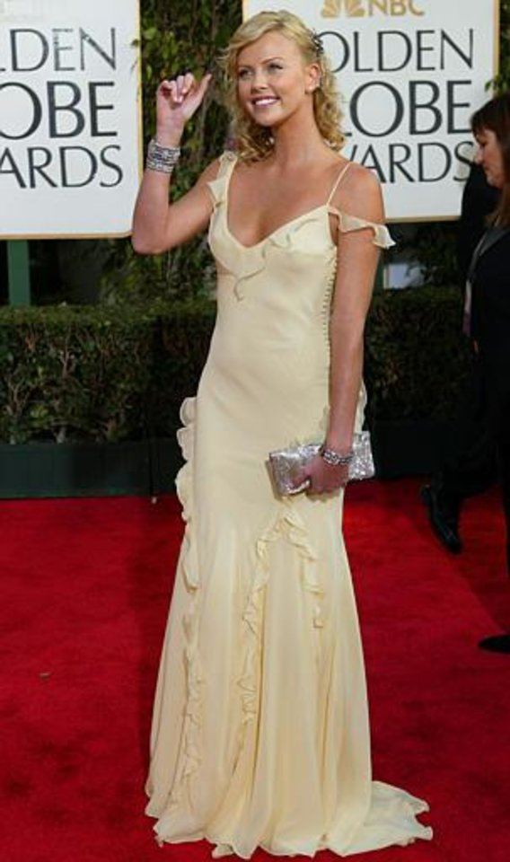 Charlize Theron, who won best actress in a drama for her work in Monster, arrives for the 61st Annual Golden Globe Awards on Sunday, Jan. 25, 2004, in Beverly Hills, Calif. (AP Photo/Kevork Djansezian)