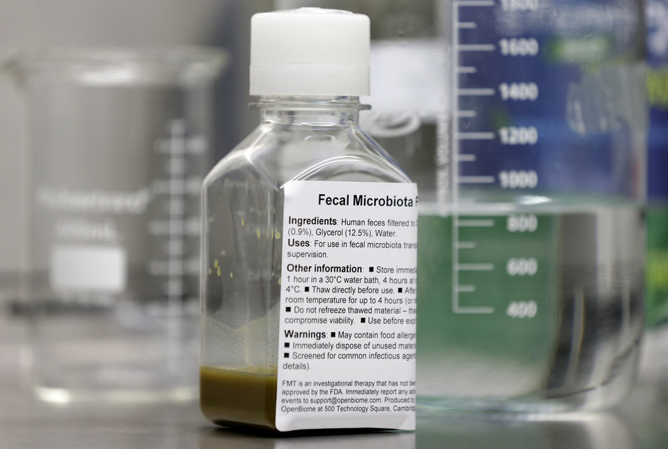 Photo - In this Thursday, June 19, 2014 photo, a bottle containing human fecal matter solution sits in an OpenBiome laboratory, in Medford, Mass. Fecal transplants pose a unique challenge for the Food and Drug Administration, which has been trying to confirm the safety of the new therapy by regulating it as an experimental drug. (AP Photo/Steven Senne)