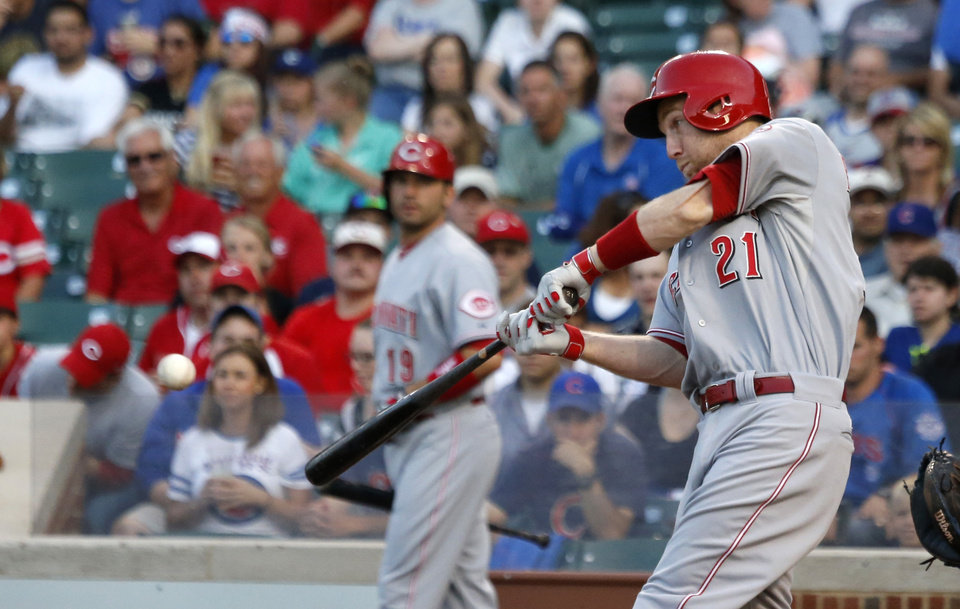 Photo - Cincinnati Reds' Todd Frazier hits an RBI triple off Chicago Cubs starting pitcher Jeff Samardzija, scoring Billy Hamilton, during the first inning of a baseball game Monday, June 23, 2014, in Chicago. (AP Photo/Charles Rex Arbogast)