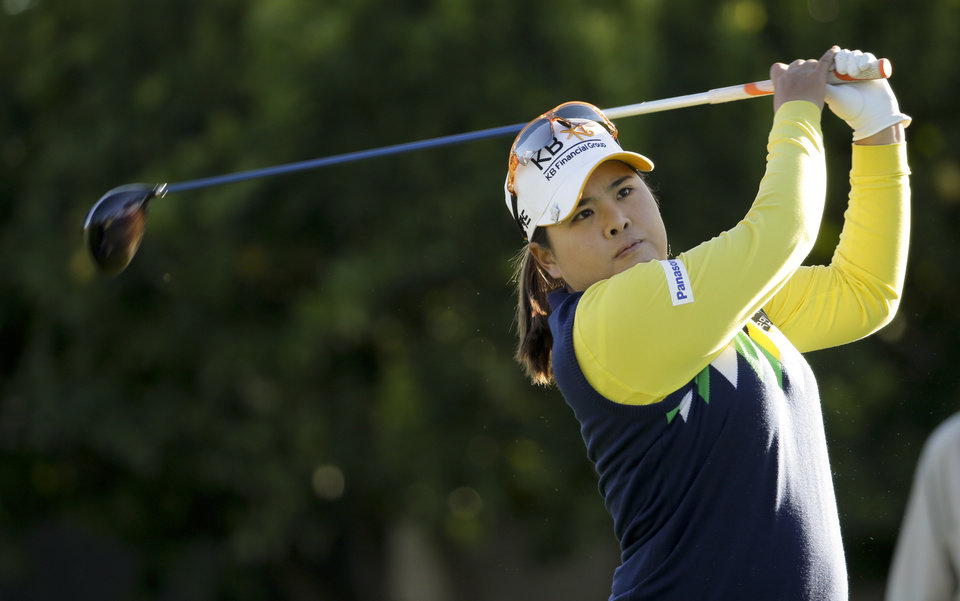 Photo - Inbee Park, of South Korea, watches her tee shot on the 11th hole during the first round at the LPGA Kraft Nabisco Championship golf tournament Thursday, April 3, 2014 in Rancho Mirage, Calif. (AP Photo/Chris Carlson)