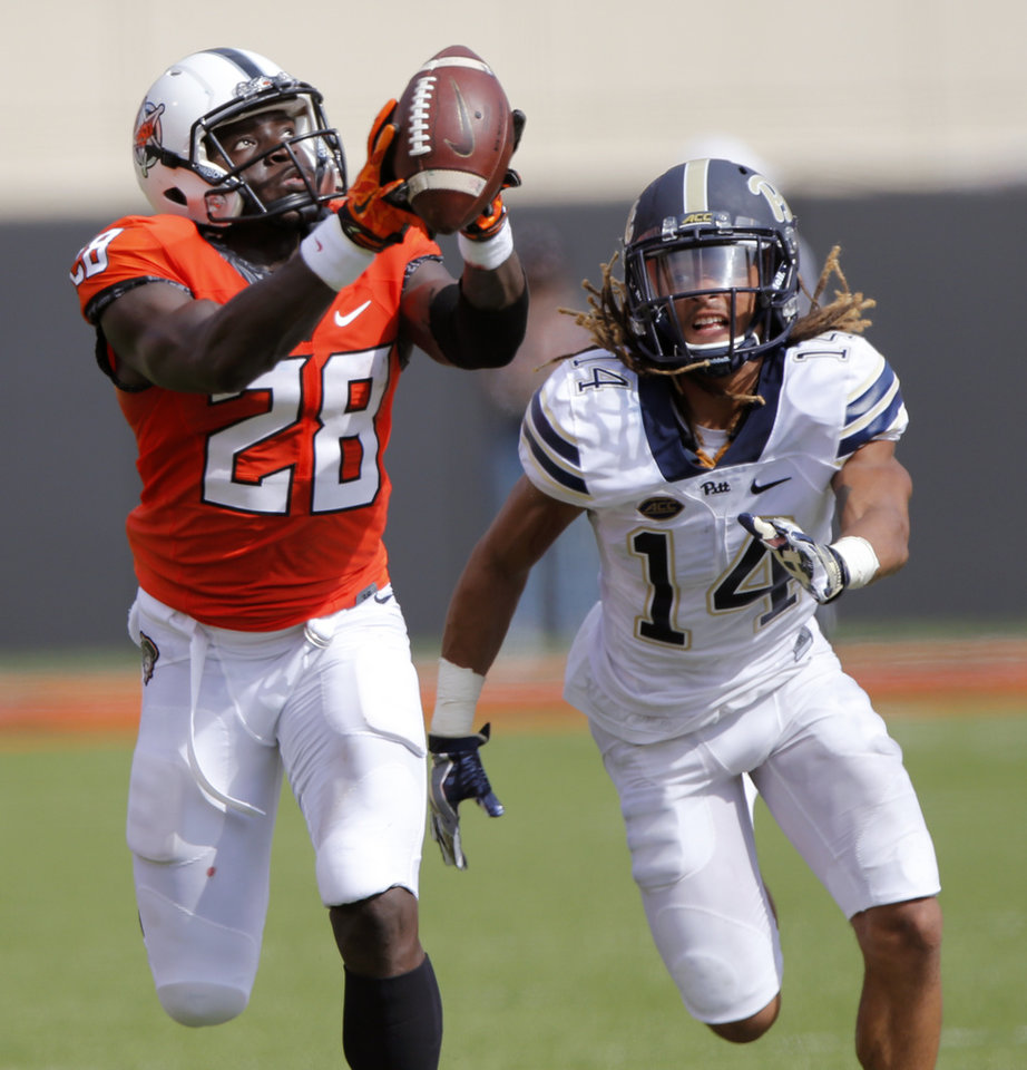 Photo - Oklahoma State's James Washington (28) makes a touchdown catch in front of Pittsburgh's Avonte Maddox (14) during a college football game between the Oklahoma State Cowboys (OSU) and the Pitt Panthers at Boone Pickens Stadium in Stillwater, Okla., Saturday, Sept. 17, 2016. Photo by Chris Landsberger, The Oklahoman