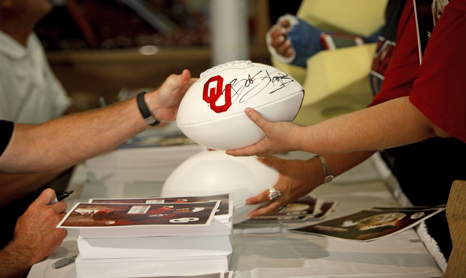 Oklahoma football coach Bob Stoops signs a football for a fan during the Sooner Caravan stop at the National Cowboy & Western Heritage Museum  in Oklahoma City, Wednesday, August 1, 2012. Photo by Bryan Terry, The Oklahoman
