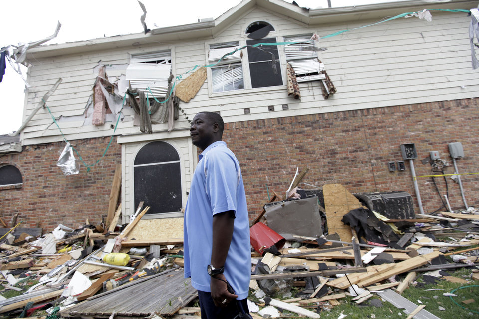 Photo -   Charles Paige stands amongst tornado debris as he surveys the damage to his home Wednesday, April 4, 2012, in Forney, Texas. The mayor of Forney, Texas, says it's