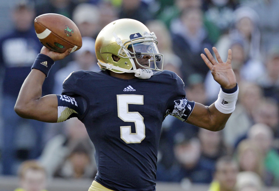 Photo - FILE -- In this Nov. 17, 2012 file photo, Notre Dame quarterback Everett Golson throws against Wake Forest during the first half of an NCAA college football game in South Bend, Ind. Golson has reclaimed the job as Notre Dame's starting quarterback after being suspended last semester for academic impropriety. Coach Brian Kelly on Wednesday said Golson would start against Rice on Aug. 30 and said he hopes he will be the starter for the entire season. (AP Photo/Michael Conroy, file)