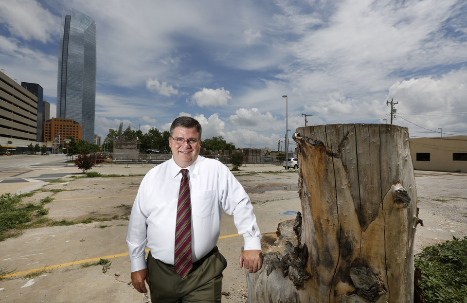 Photo - Attorney John Hunsucker stands on the future site of the Hunsucker Legal Group offices at 600 W Sheridan.  Steve Gooch - The Oklahoman