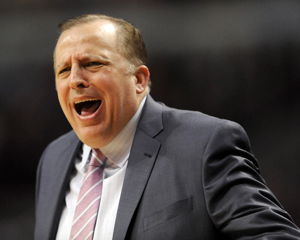 Photo - Chicago Bulls head coach Tom Thibodeau yells to his players during the second quarter of an NBA game against the Charlotte Bobcats in Chicago, Monday, Nov. 18, 2013. (AP Photo/Paul Beaty)