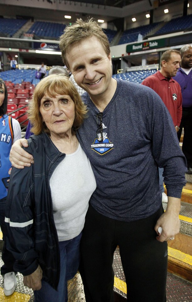 Oklahoma City Thunder head coach Scott Brooks is seen with his mother, Lee Brooks, Feb. 12, 2011, after the Thunder defeated the Sacramento Kings in the California capital. Brooks, who was raised solely by his mother, credits her for playing the biggest role in molding him into a head coach.  AP ARCHIVE PHOTO